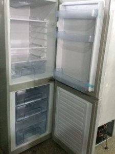 Solar DC refrigerator with bottom freezer